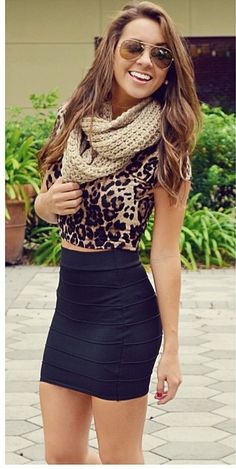 black skirt with leopard print blouse and a tan scarf.  Look good put out together