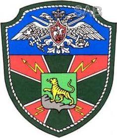 Нарукавный знак военнослужащих полка связи (г. Владивосток). Утвержден 24 января 1998 года.