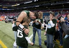 Tim talking to one of his W15H kids. Tim Tebow - New York Jets v St Louis Rams