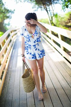 Summer Style via Glitter & Gingham // Blue & White Floral Romper, Target Straw Beach Bag, Body Glove Bikini, Ray-Ban Aviators