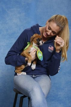 Puppy love: Michael Phelps, Venus Williams, Alex Morgan and other Olympic athletes lend a hand to help animals up for adoption Olympic Athletes, Olympic Sports, Olympic Games, Olympic Volleyball Players, Usa Volleyball, Volleyball Articles, Kerri Walsh Jennings, Go Usa, Michael Phelps