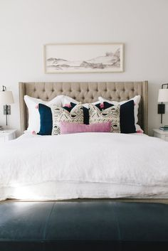 feminine bedroom with tufted headboard