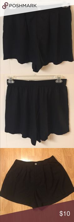 "🐷VS Flowy Dress Shorts NWOT New without tags Victoria's Secret London Jean black flowy dress shorts in size 10. Lightweight fabric 100% viscose. Button zipper closure with elastic back. Waist 15"" stretches to 17"" due to elastic back, Inseam 2 1/2"". Victoria's Secret London Jean Shorts"