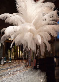 White feather centerpiece and hanging crystals and pearls make a fabulous statement.