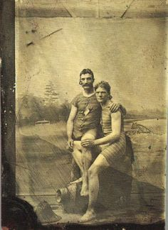 Two friends in bathing suits, details unknown.