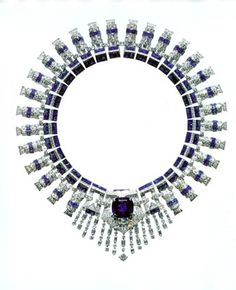 """Platinum sapphire and diamond Art Deco necklaces was createdby Cartier for Majorie Merriweather Post and is a perfect example ofthis style.  With a huge and perfect blue sapphire in the center ofthis neckpiece with pave set diamond and sapphire bar shaped chain, theentire necklace could be unclipped and worn as two bracelets and thecenter large sapphire as a brooch.  Mrs. Post called this her """"bluejewelry."""""""
