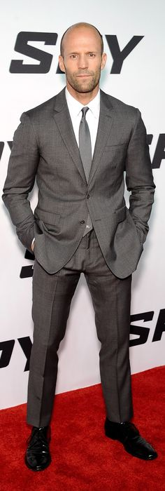 British actor Jason Statham wearing a grey Burberry suit on the red carpet for the New York premiere of 'Spy'