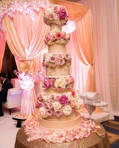 Six tiers of fresh flowers with fondant accents and lace adorned. Thanks La Moda Photography
