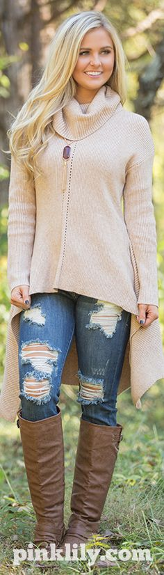 This may just be our FAVORITE new sweater! The color, the cut, and the comfy style make this one of a kind piece the perfection addition to your closet.
