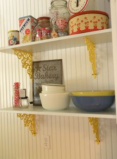 "Yellow shelf brackets... For ""mantle"" shelf above tv"
