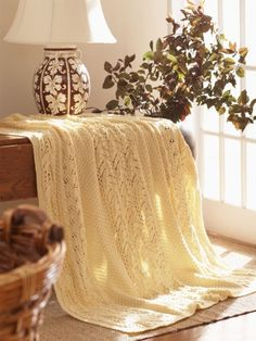 Free Pattern - Featuring cable and lace details, this #knit afghan is an elegant and cozy home decor essential.