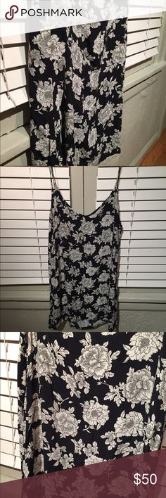 Brandy Melville deep V black and white dress. Lightly worn, no damages. Black and white rose patterned dress Brandy Melville Dresses