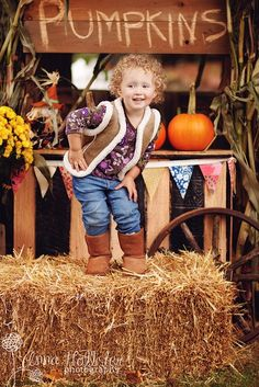 Cute pumpkin and hay props for an October photo session