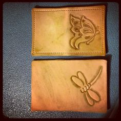 Carved leather card wallets.