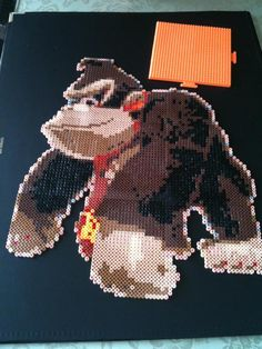 Donkey Kong perler beads by Cea P - Perler® Cartoon Caracters, Donkey Kong, Bead Art, Perler Beads, Beading Patterns, Pixel Art, Needlepoint, Video Games, Helmet