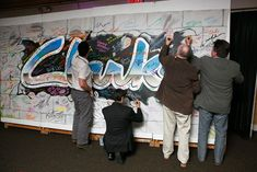 As guests entered, they tagged a graffiti wall created by Artists for Humanity. The banner now hangs in Clarks's customer service department. Photo: Michael Blanchard Photography