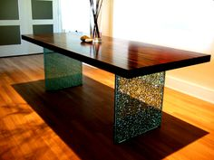 Mark Hawley's design innovation - the shattered glass leg - adds stunning elegance to this contemporary versatile table.
