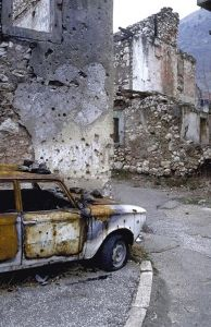 Bosnia and Herzegovina - Mostar. Scenes like this do not magically disappear once a war is over. I was there in 2011 and while a car like this would be cleared out, the shell and bullet holes still pockmark the walls. Pinned from http://www.ehl.icrc.org/index.php?option=com_joomgallery=detail=34=544#joomimg