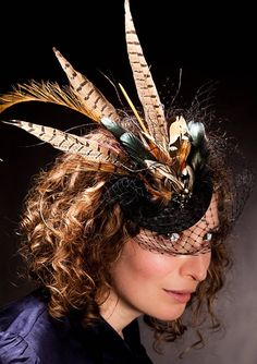 Not quite it but i love the pheasant feathers and I want a veil with color added.  Feather Fascinator by Kate Davison