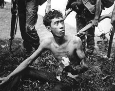 VIETNAM 1968    A young Viet Cong soldier looks up at his captors after being captured near Tan Son Nhut Airbase. May 6, 1968.