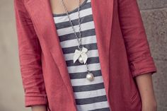 This reminds me of my favorite look when I pair my grey striped shirt with my salmon blazer...aaaand borrow my sister's long necklaces. :]