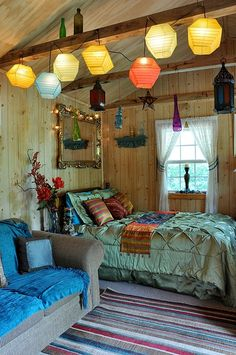 Bohemian Style Decor - The lights separate the bed from the couch. Great idea for a studio apartment.