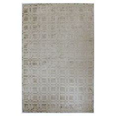 Hand-loomed art silk rug in platinum with an understated geometric motif.   Product: RugConstruction Material: 100% Viscose pileColor: PlatinumFeatures:  Made in IndiaHand-loomed Note: Please be aware that actual colors may vary from those shown on your screen. Accent rugs may also not show the entire pattern that the corresponding area rugs have.Cleaning and Care: Regular vacuuming. Spot cleaning recommended.