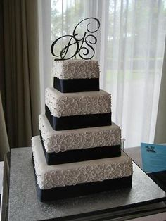 Wedding Cake I love this too its really simple maybe this one with the scrolls in white and the ribbons in red and I love the letters on top