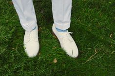 O'Connell's white duck forward pleat trousers, MacNeil & Moore White Bucks, and Marcoliani Blue crew socks.