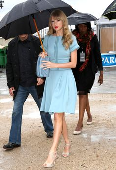 Taylor Swift Street StyleSweet dress with red lips: Rain doesn't get this lady down! Swift revvs up her baby blue dress with vivid red lips. Adding the pop of color takes this look from demure to bold. via StyleList