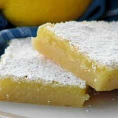 The Best Lemon Bars Recipe - made these for dessert tonight with lime juice instead of lemon. Add a little green food coloring and you have lime bars. They are yummy! Just Desserts, Delicious Desserts, Yummy Treats, Sweet Treats, Yummy Food, Health Desserts, Best Lemon Bars, Cookie Recipes, Dessert Recipes