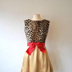 Meow!! Love this leopard cocktail dress on #threadflip