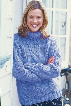 Chunky cable sweater for a woman with roll neck and wide ribbed edge. Shop this pattern at The Knitting Network