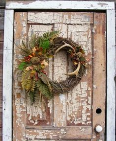 my deer antler wreath smaller slightly different than the crafts, seasonal holiday decor, wreaths Hunting Wreath, Antler Wreath, Acorn Wreath, Moss Wreath, Feather Wreath, Boxwood Wreath, Deer Antler Crafts, Deer Antlers, Hunting Crafts