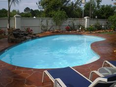 Small kidney shaped fiberglass pool with beautiful decking this the pool we have choosen to be in our back yard