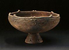 Clay pot of the with a table. B.C.1200-B.C.400. Jomon period. Tohoku Region.