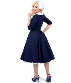ClhRmbhfWx_Unique_Vintage_Navy_Ivory_Three-Quarter_Sleeve_Eva_Marie_Stretch_Swing_Dress.jpg (1095×1275)