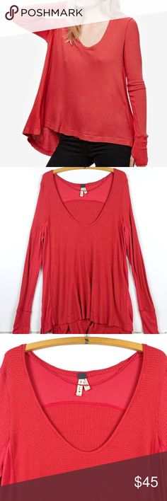 """Free People Washed Red Malibu Thermal Free People We The Free Malibu Thermal in washed red (burnt orange color) Size large - bust 24"""" length 24""""/30"""" New with out tags  Cut from a super soft thermal knit, this cozy top gets a stylish update in the form of a swingy back panel that adds playful volume to the casual silhouette.   Thumbholes / oversized fit / relaxed body with fitted sleeves Free People Tops Tunics"""