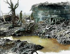 Canadian soldiers survey a smashed German bunker. Battle of Passchendaele, July to November 1917