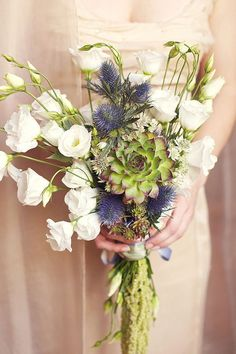 Pretty summer time Bridal bouquet with succulents...