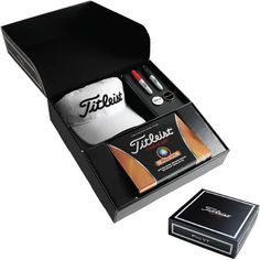 The perfect gift for your corporate clients or participants at your next golf event. The Titleist gift box features 1 dozen custom ProV1x golf balls. Also includes 1 stock Titleist ProV1x white hat, 2 Titleist Sharpie mini's (red and black) and 2 Titleist Pro V1x ball markers. | DL Events + Promotions