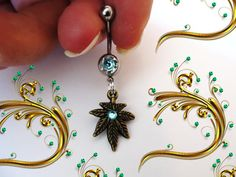 Hey, I found this really awesome Etsy listing at http://www.etsy.com/listing/117311664/sale-belly-ring-antique-bronze-cannabis