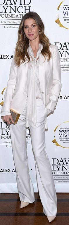 Who made  Gisele Bundchen's white pants suit and stone print clutch bag?