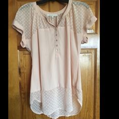 Pale pink/peach short sleeve blouse- so pretty! Pale peach/pink blouse with sheer polka dot accents- pearlescent buttons. Long enough to wear with leggings. Soft fabric. Can be easily dressed up or down. Size medium, but slightly flowy Daniel Rainn Tops Blouses