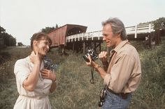 The Bridges of Madison County  no matter how many times I see this movie, two things happen, I still hope she opens the car door and I still cry like crazy!