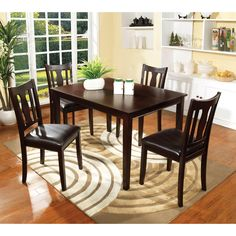 The perfect set for any home with its simple transitional design. Set comes with a stunning rectangular dining table with four dining chairs that offers great comfort with padded leatherette seats in a rich espresso finish.