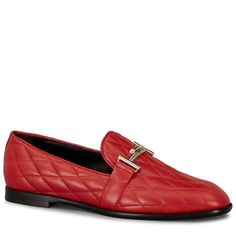 Moccasin in elegant soft leather with matelassè effect, Tod's Double T metal clamp and leather sole.