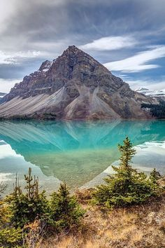 I can't believe how still this lake is and the reflection of the mountain here! Turquoise reflection at Bow Lake, Banff National Park, Alberta - Canada. Beautiful World, Beautiful Places, Peaceful Places, Photos Voyages, Canada Travel, Canada Canada, Parks Canada, Places Around The World, Beach Trip