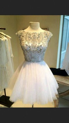 Short wedding dress would be pretty for wedding rehearsal or reception. - love the top of this dress