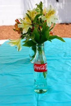 Baby Q centerpieces---- If only I had a mother with a vast collection of coca cola bottles.........